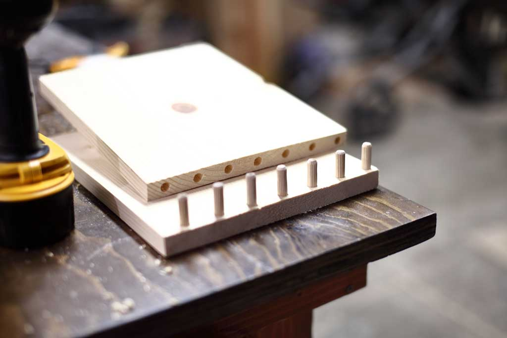 dowels inserted for DIY Offsetting bookshelf