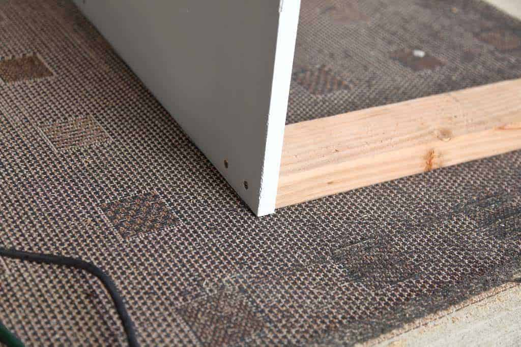 attach 2x4s to side boards of the DIY Closet Organizer with Drawers