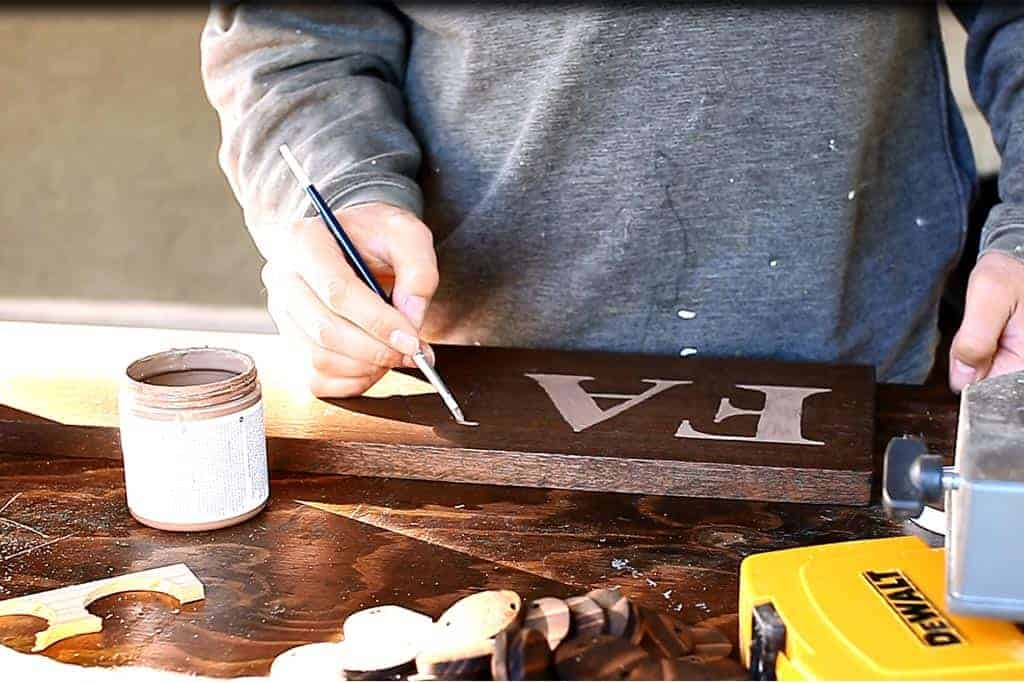painting the text of the DIY Family Calendar Board