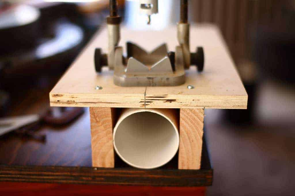 jig to cut holes in the pvc pipe for DIY PVC Pipe Patio Railing