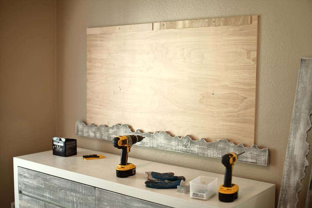 attaching backboard of DIY Live Edge Mirror to wall