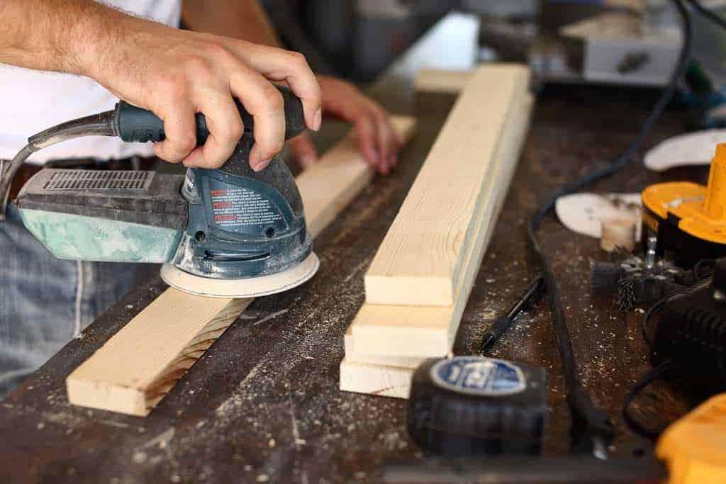 sanding wood with sander