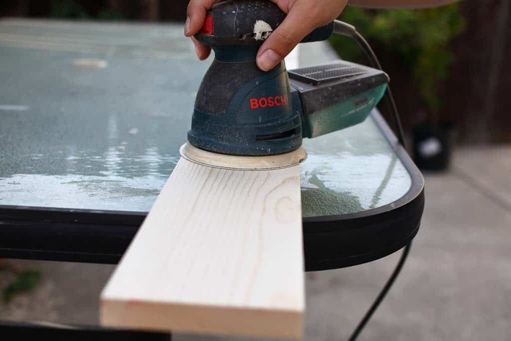 sanding wood for growth ruler