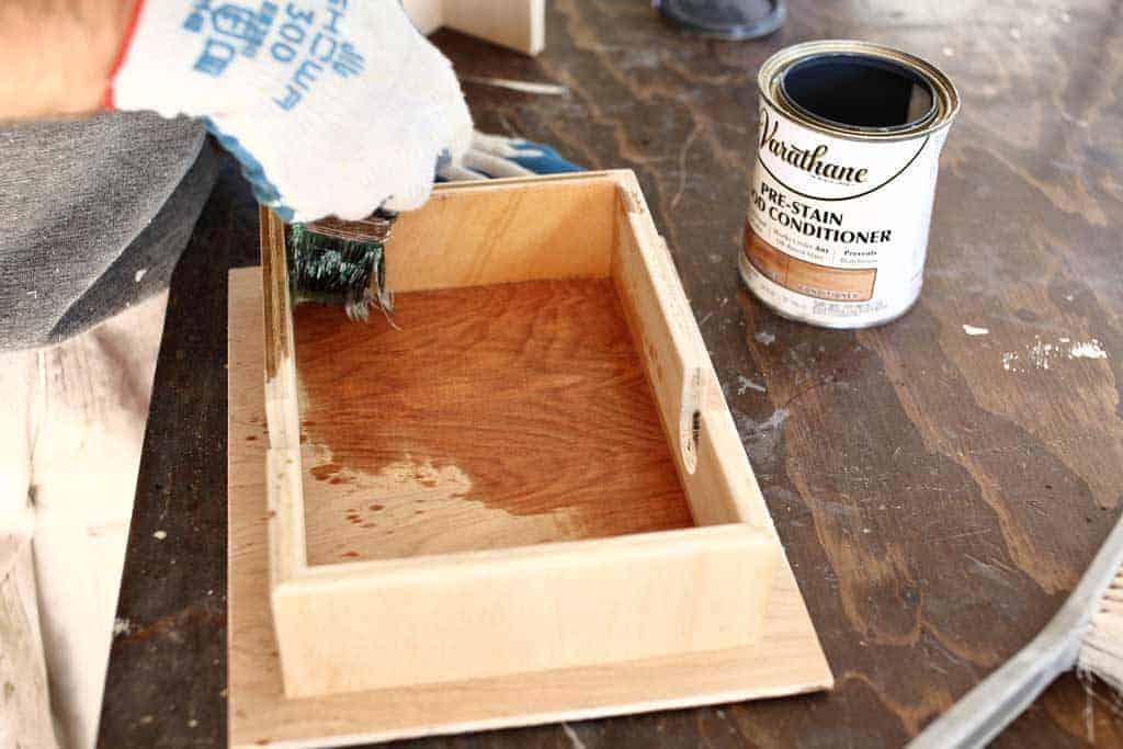 apply pre stain on the DIY Napkin Holder
