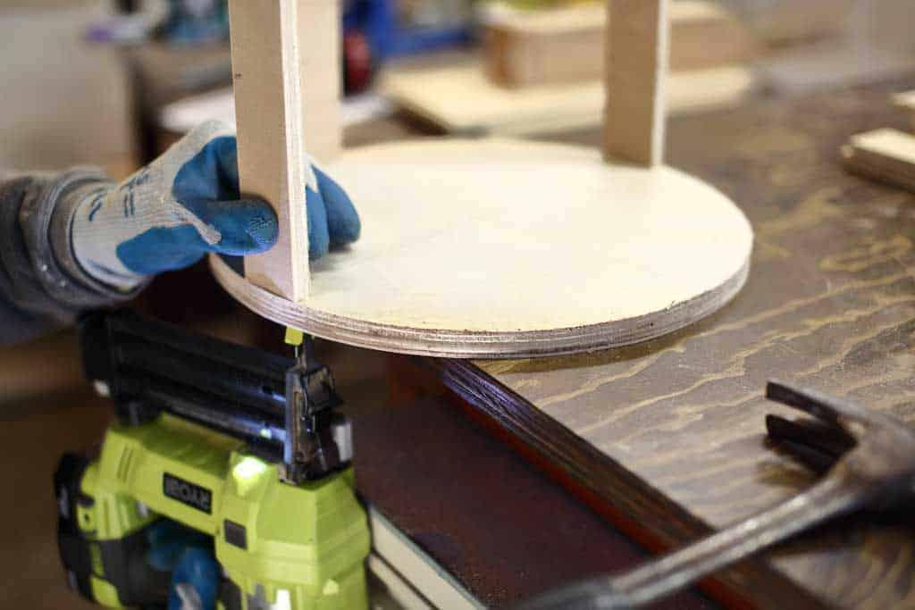 using staple gun to attach wood to round disk