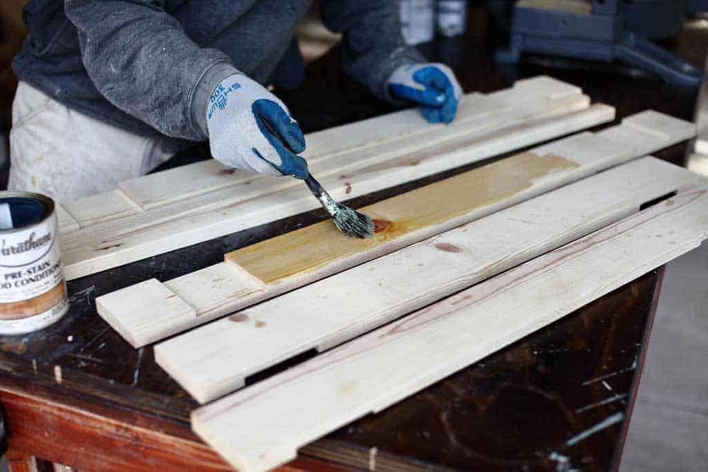 applying pre stain on wood