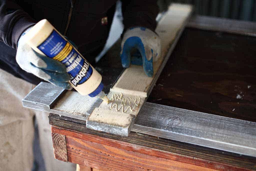 applying wood glue inside the notch