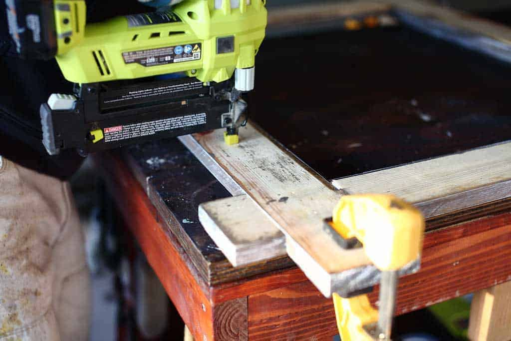 using nail gun to secure wood for mirror frame
