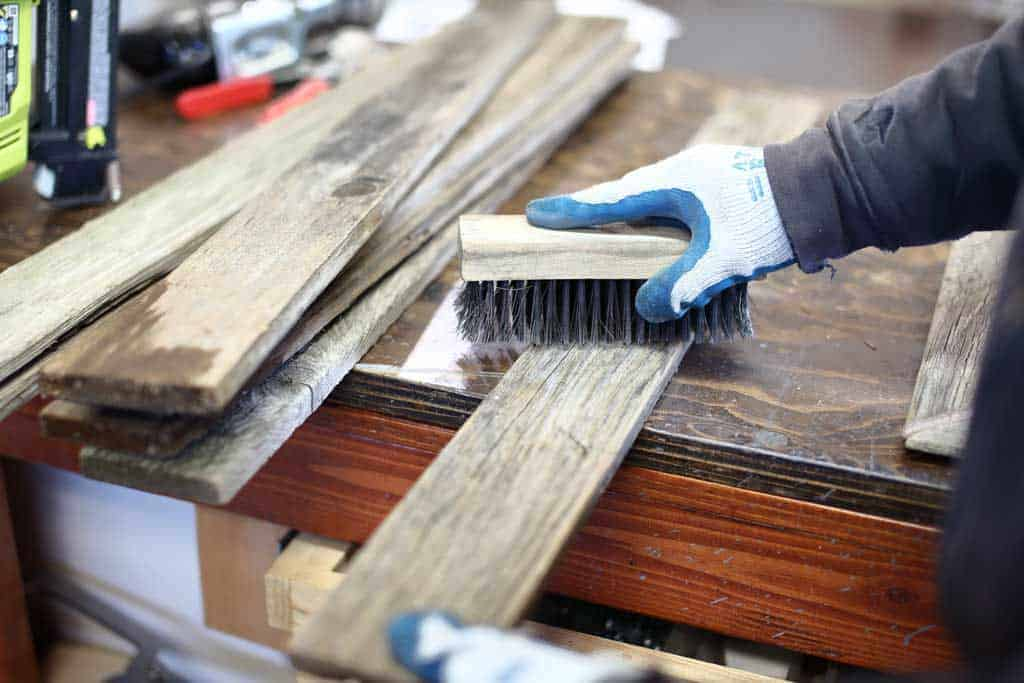 cleaning the wood boards for DIY Reclaimed Wood Frame Sign