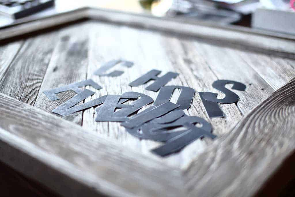 taping letter for DIY Reclaimed Wood Frame Sign