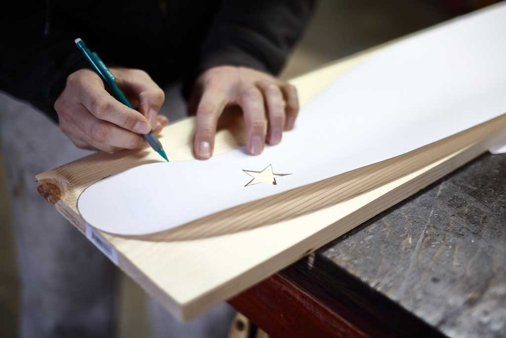 tracing over the template for DIY Curved Shelf