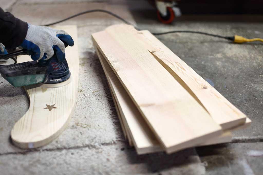 sanding DIY Curved Shelf boards