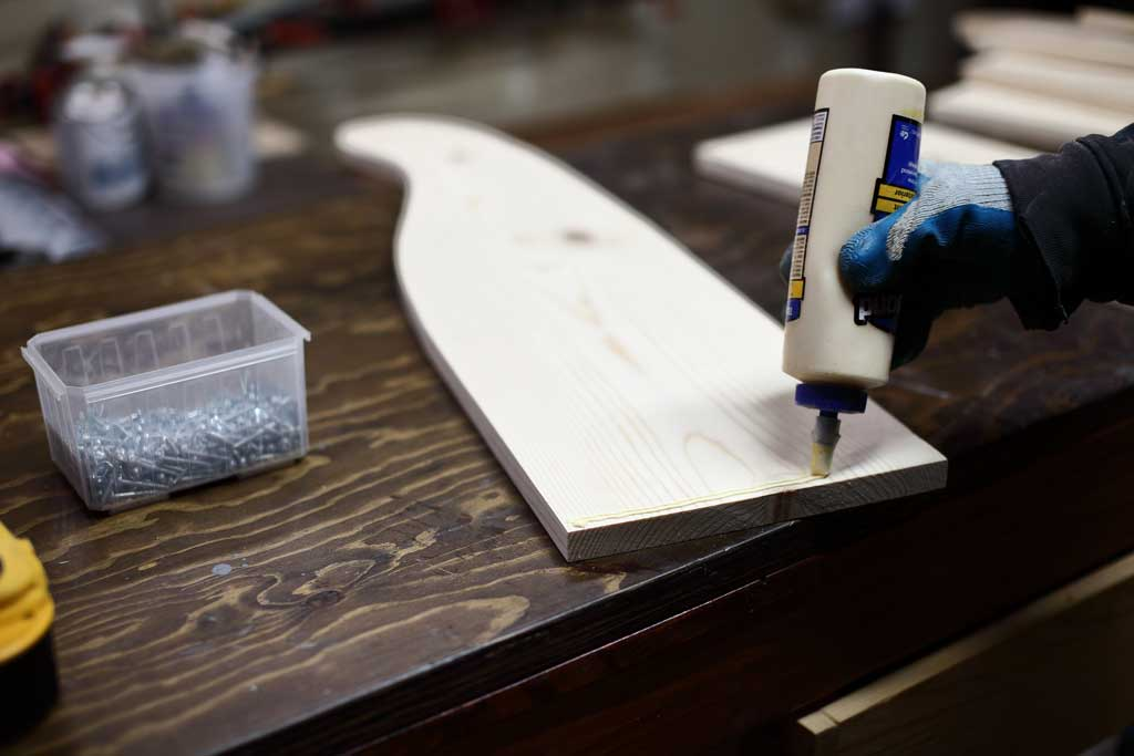 applying wood glue on the DIY Curved Shelf