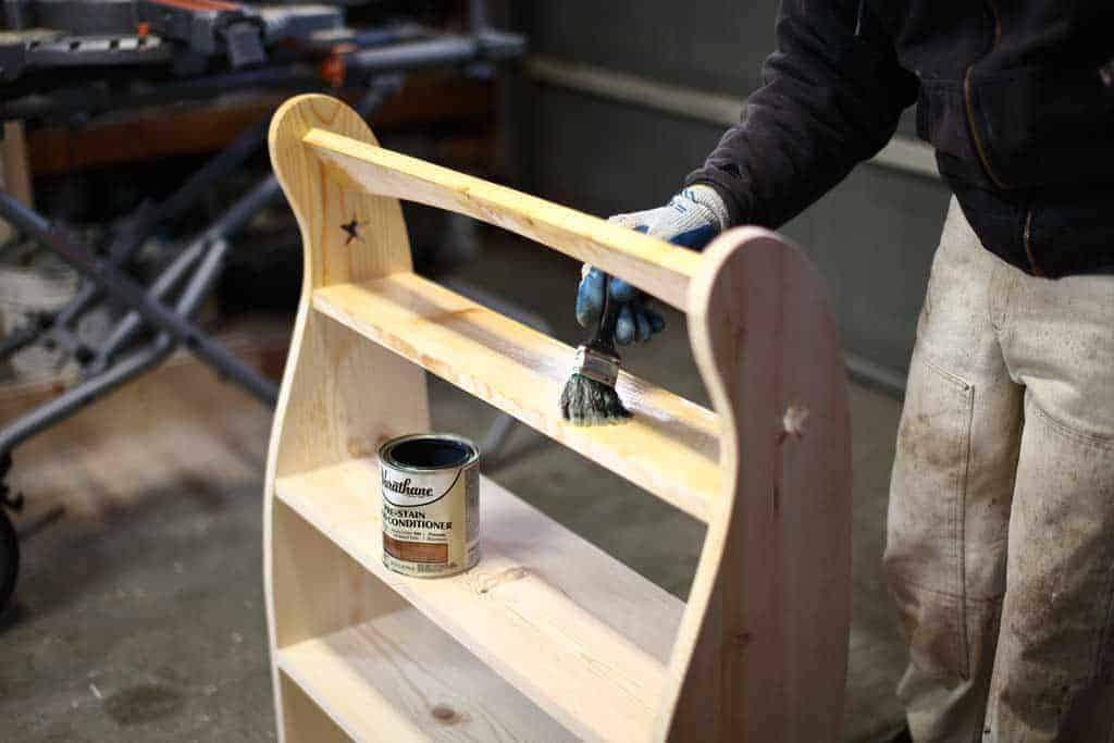 applying coat for pre-stain on DIY Curved Shelf