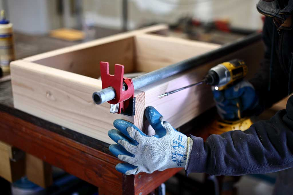 assembling lower bin frame for DIY Sensory Table