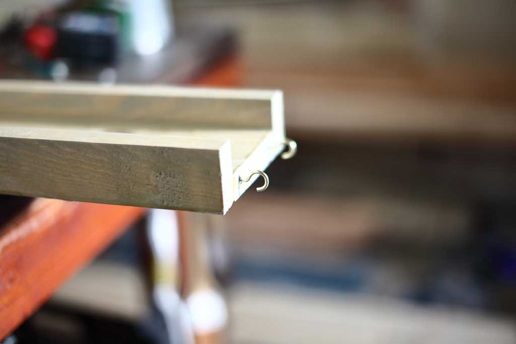 attaching cup hooks for water ramps on DIY Sensory Table