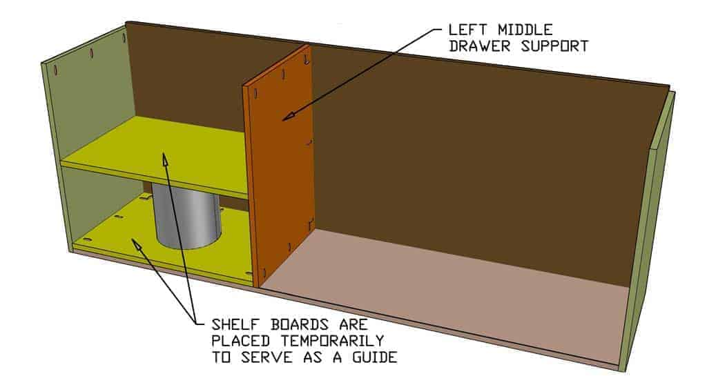 installing middle drawer support boards of the DIY Garage Cabinets