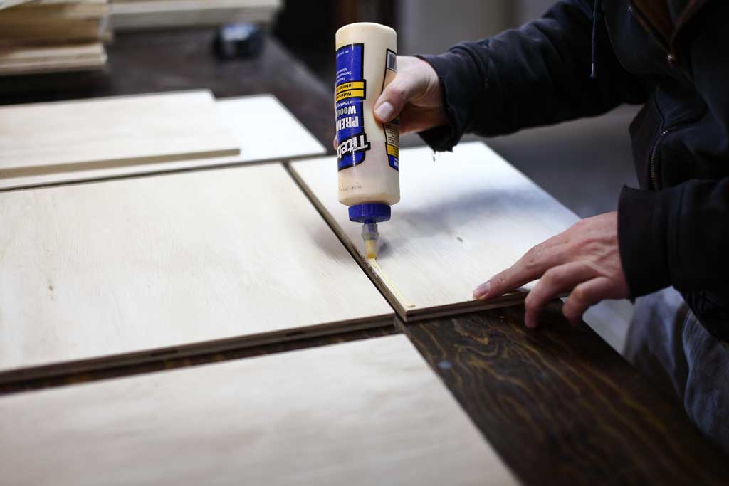 gluing drawer boxes together for DIY Garage Cabinets