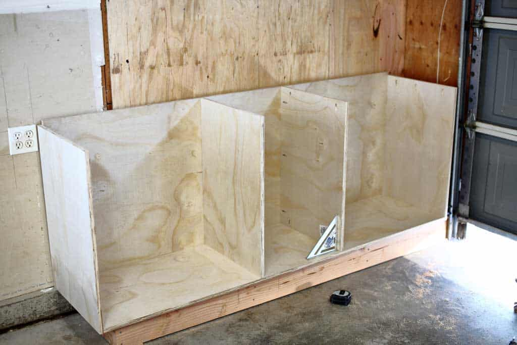 installing the middle pieces of the DIY Garage Cabinets