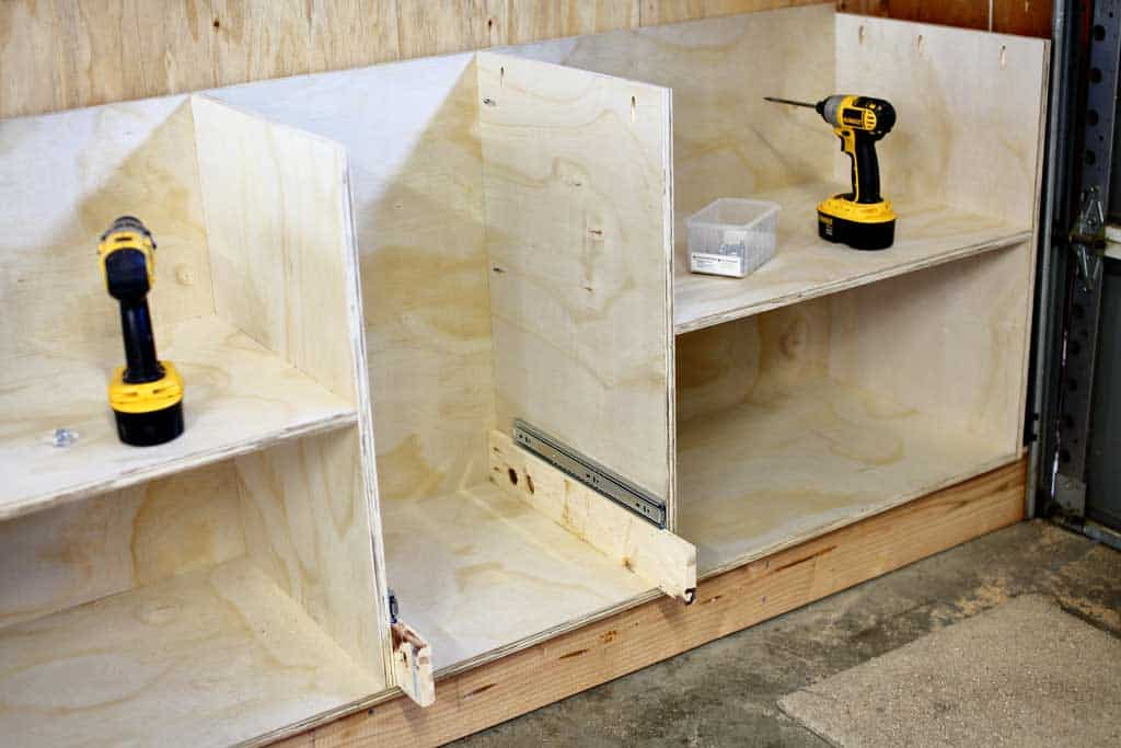install the bottom slide of the DIY Garage Cabinets