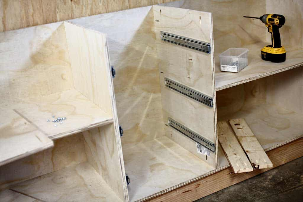 installing drawer slides for the DIY Garage Cabinets