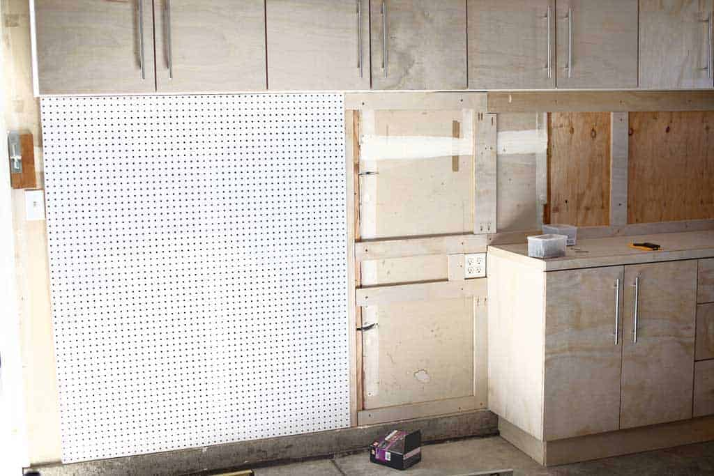 attaching pegboard on the wall