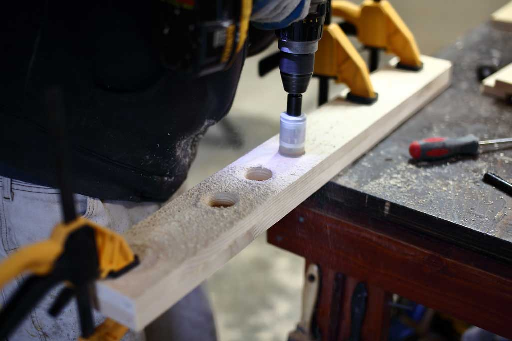 drilling holes for adjustable step of the DIY Toddler Step Stool