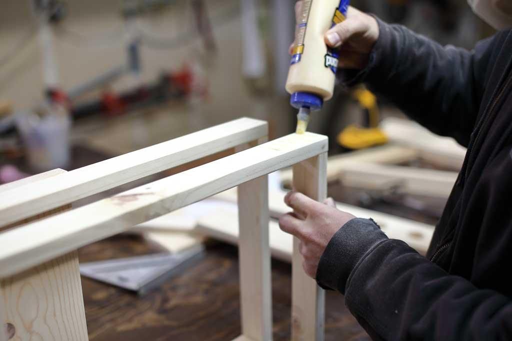 gluing the back leg of the DIY Toddler Step Stool