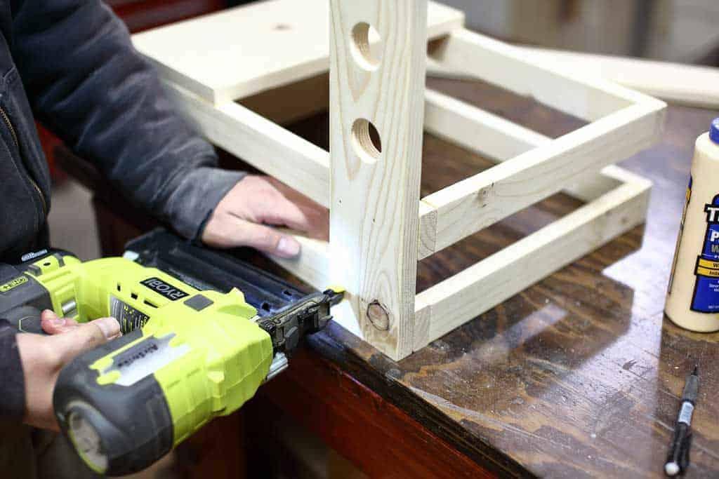 nailing the back leg of the DIY Toddler Step Stool