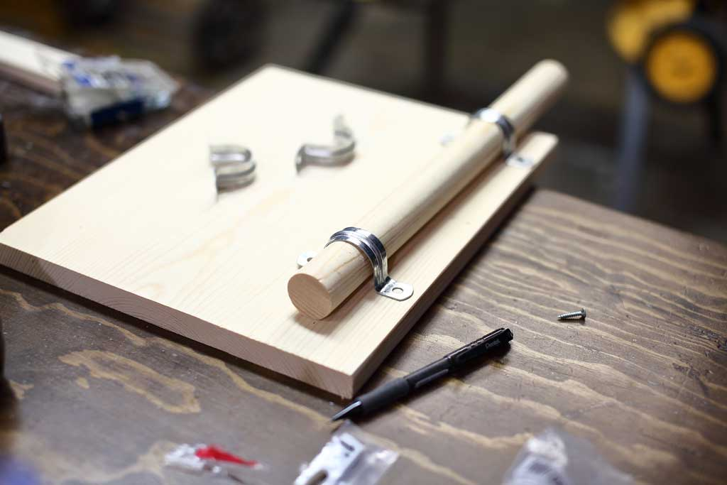 attaching dowel rod with a ridged strap