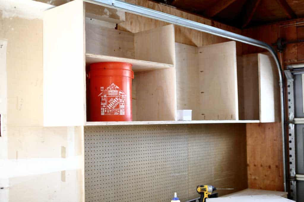 attaching dividers on the garage cabinets