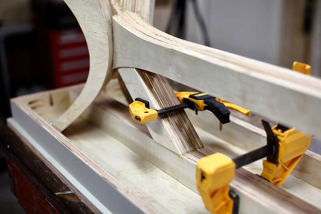 attaching diagonal brace supports under the bench