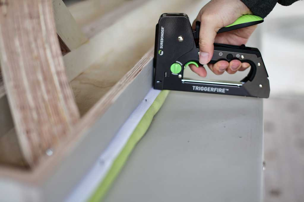 stapling fabric to bench seating