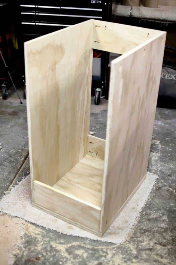 attaching back piece of the DIY Mobile Tool Cart with Pegboard