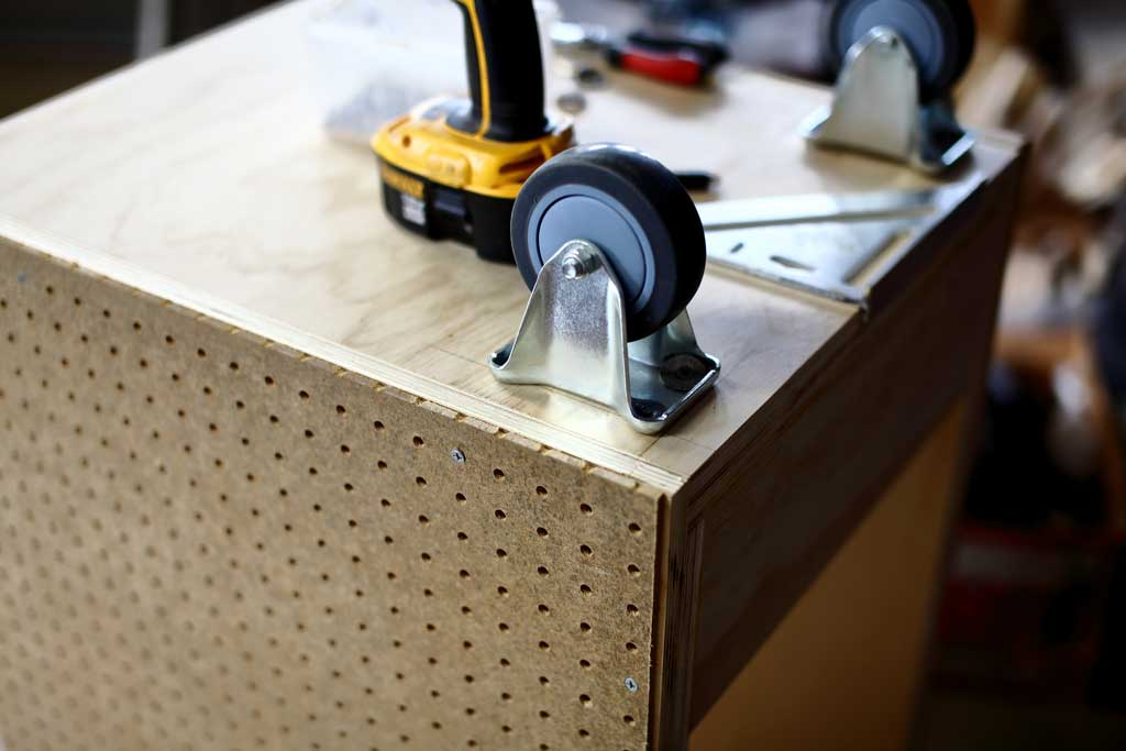 installing wheels on the DIY Mobile Tool Cart with Pegboard