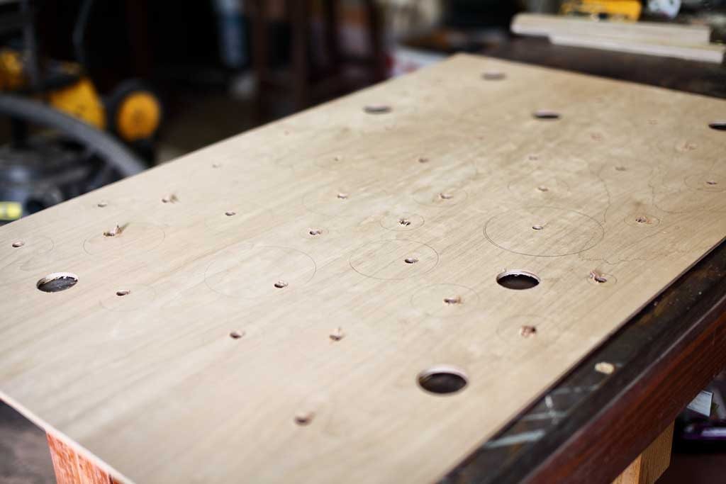 drilling holes in the plywood