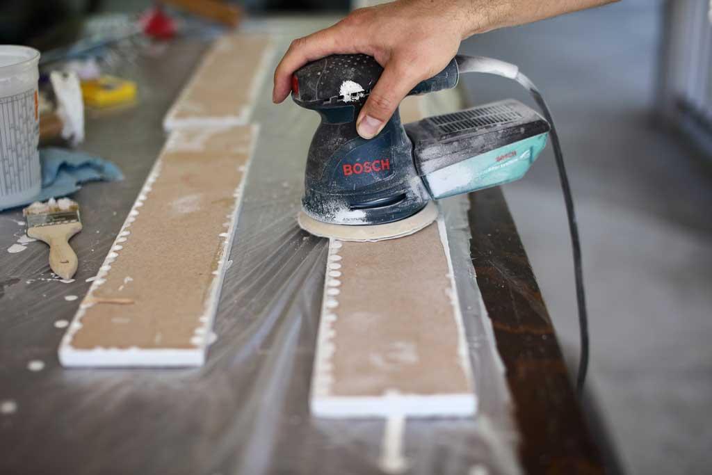 using sander to sand backsplash