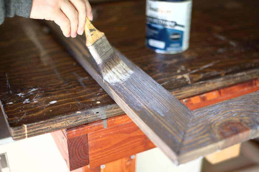 applying polyurethane on DIY mirror frame