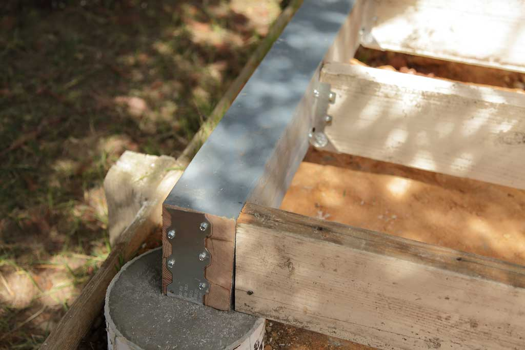 Simpson strong tie attaching to foundation of DIY Chicken Coop