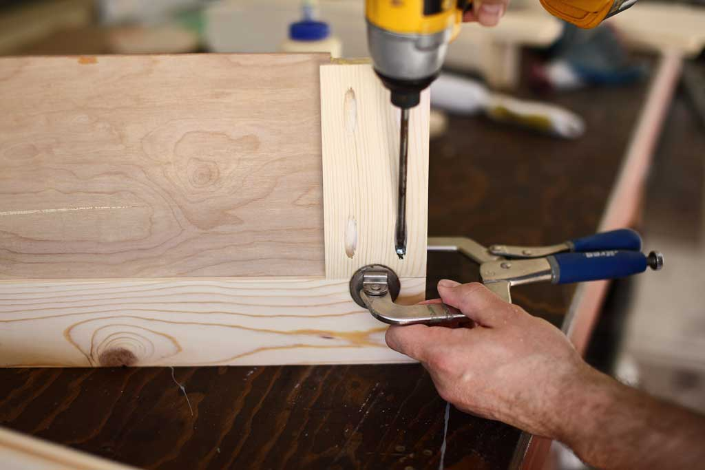 using pocket hole screws to attach the cabinet door