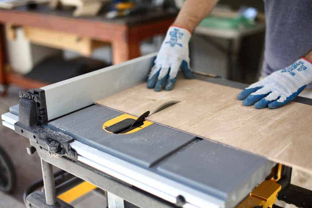 cutting plywood on table saw