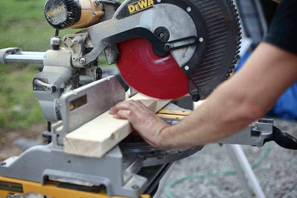 using a miter saw to cut wood