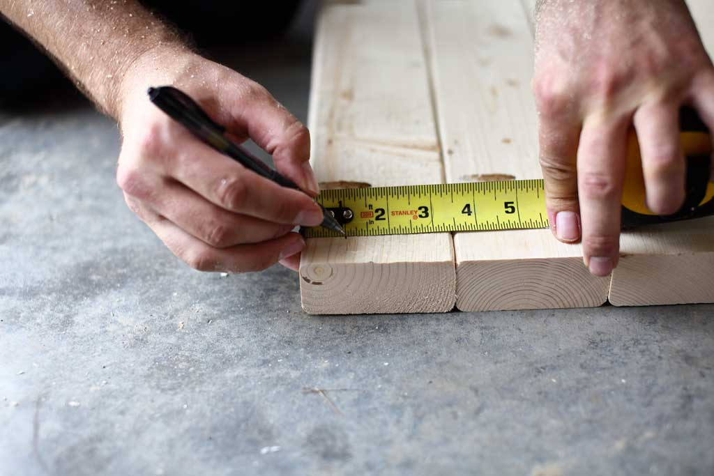 pulling a measurement for the legs on the tabletop
