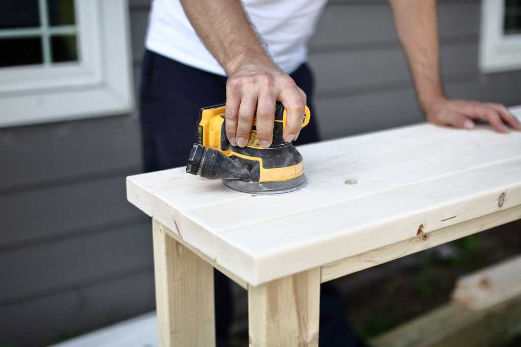 sanding DIY farmhouse entryway table