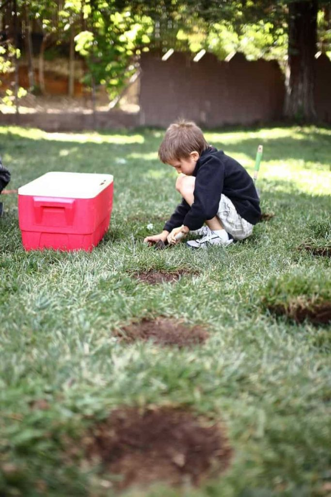 boy digging out hole for diy stepping stone