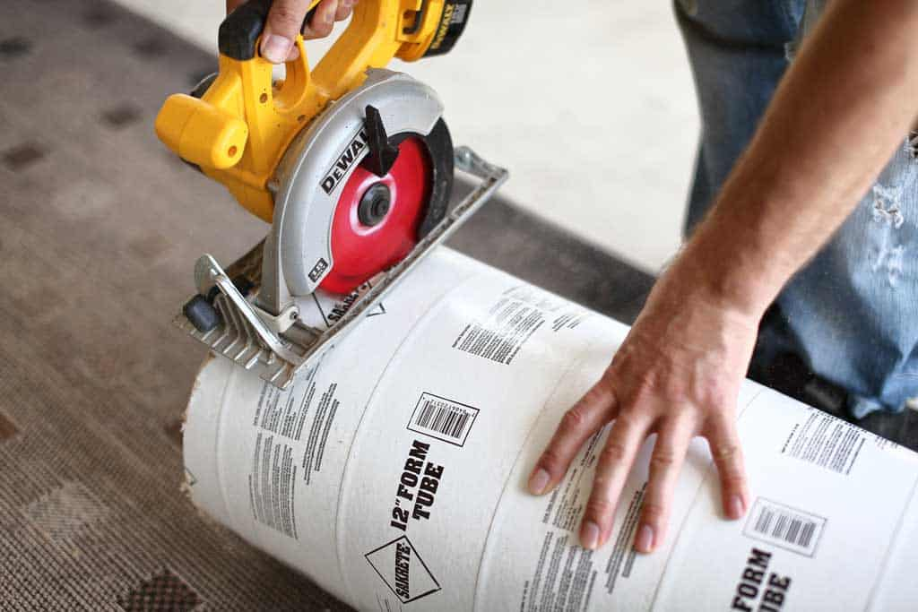 cutting concrete tube with skill saw for diy stepping stone