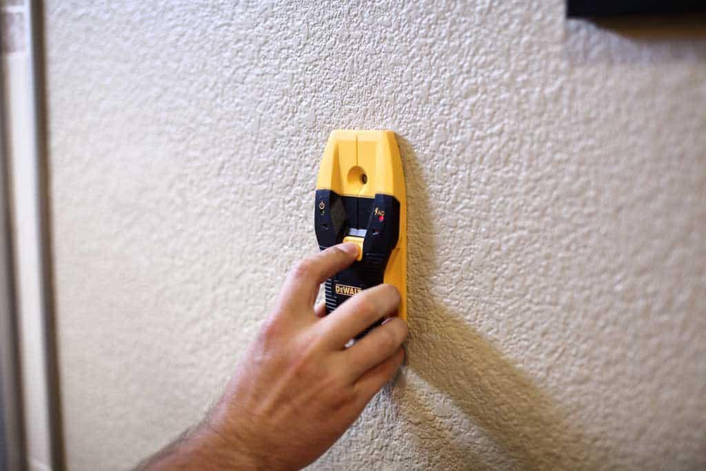 using stud finder for DIY Wooden Towel Bar