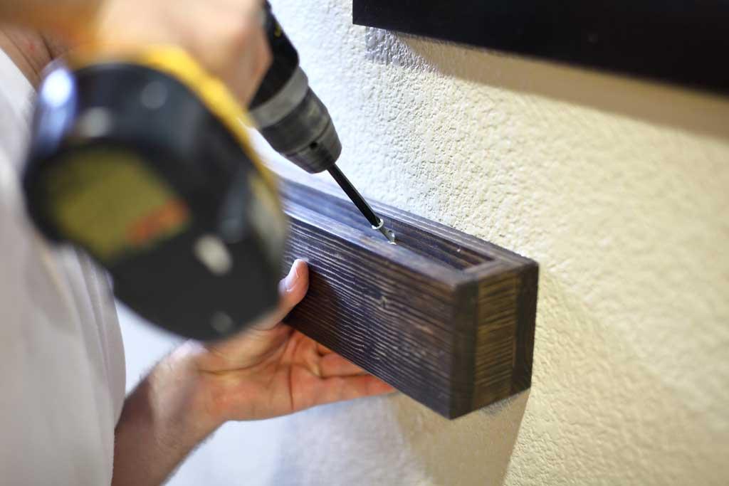 screwing in DIY Wooden Towel Bar