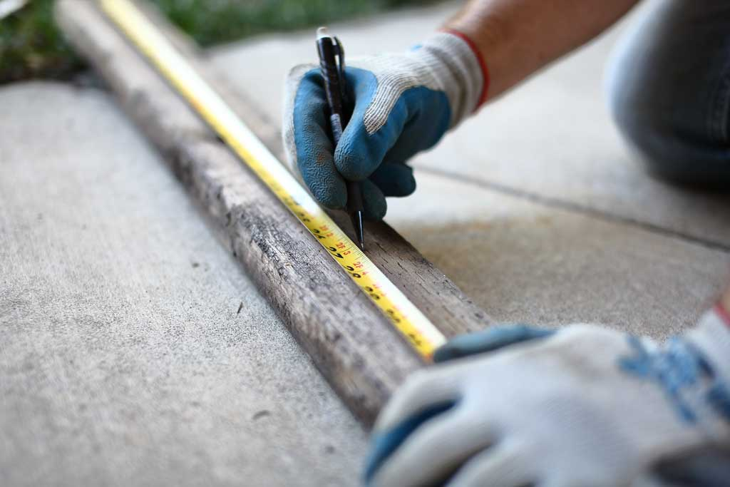 using a tape measure to cut wood