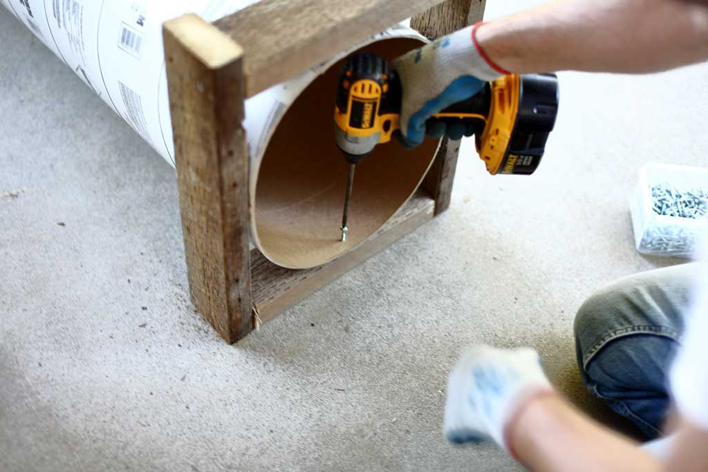attaching concrete form tube to the frame of the DIY skunk trap
